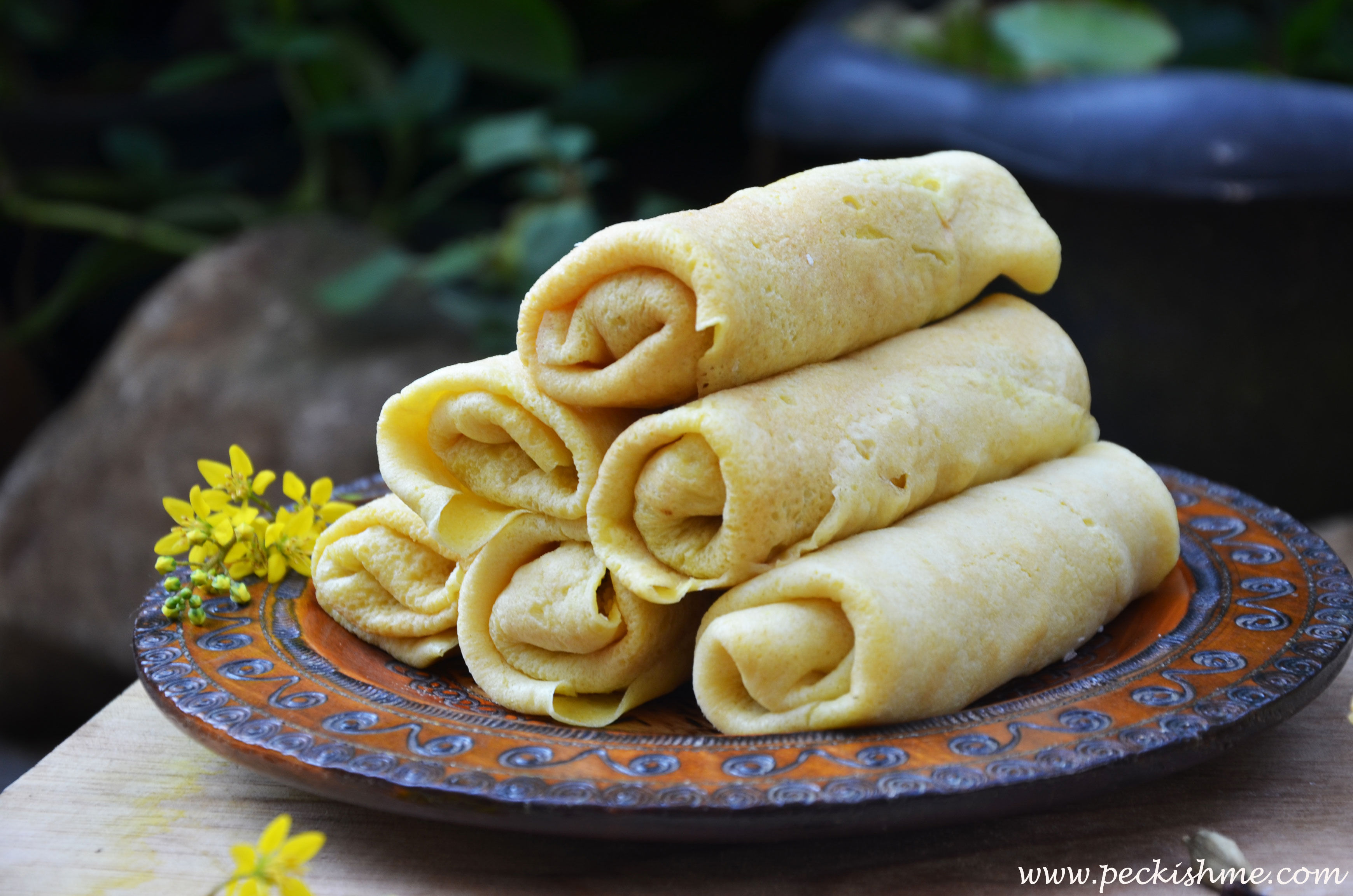 Sri lankan pancakes wellawahum peckish me a silky crepe with hints of savory turmeric enrobing an opulent body of rich dark silky coconut the tongue encounters the salty crepe first ccuart Gallery