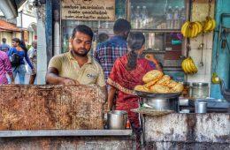 Man frying poori in india